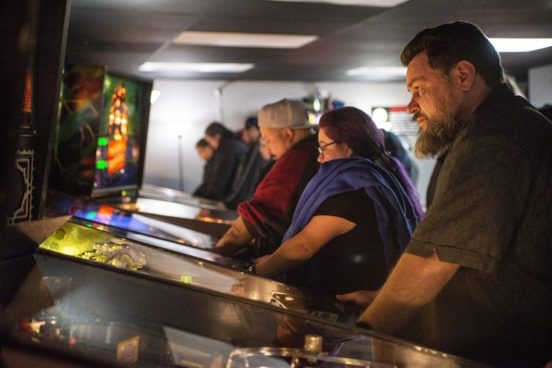 Pinball devotees and gaming enthusiasts packed the new Galloping Ghost Pinball Arcade, which opened on Ogden Avenue on March 2 to takes their turns on rare machines dating from the 1970s to the present. | Alexa Rogals/Staff Photographer