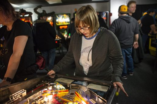 Sara Stack, of La Grange, plays the Twilight Zone pinball game on March 2, during the opening night of Galloping Ghost's Pinball Arcade on Ogden Avenue in Brookfield. | ALEXA ROGALS/Staff Photographer
