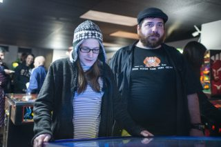 Riana Johnson, left, of Westmont, and John Kralis, of Darien, play Monster Bash on March 2, during the opening night of Galloping Ghost's Pinball Arcade on Ogden Avenue in Brookfield. | ALEXA ROGALS/Staff Photographer