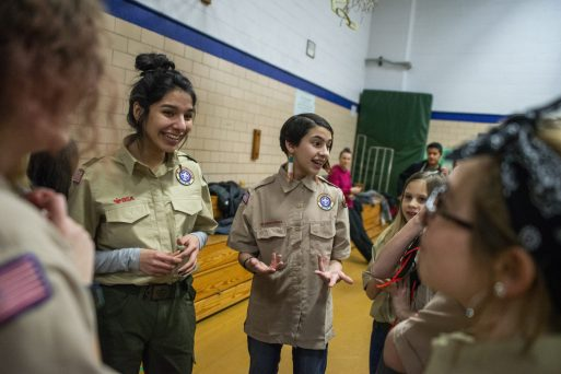 Joanna Vera, 16, left, and Elaina Markus, 12, talk with their patrol on Feb. 27, during an induction ceremony for the Boy Scouts of America Troop 90GT at Brook Park Elementary School in La Grange Park. | ALEXA ROGALS/Staff Photographer