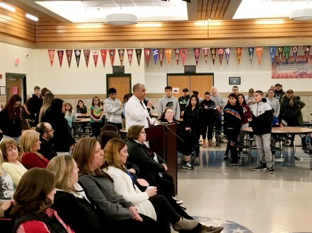 Students and parents stand in support of Robinson School Principal Al Molina as he addresses the school board Monday night. | BOB SKOLNIK/Contributor