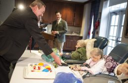 Mayor Hubert Hermanek, Jr., left, gives a plaque with a key on it to resident Lillian Herverdejs on March 21, during a birthday celebration for residents that turned 100 and over at Heritage Hall at Caledonia Senior Living and Memory Care in North Riverside. | Alexa Rogals/Staff Photographer