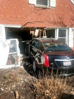 A black Cadillac CTS4 jumped the curb and crashed into a home at the corner of 28th Street and Maple Avenue in Brookfield on the afternoon of April 8. The driver sustained injuries, but no one inside the house was hurt, apart from a parrot that sustained a broken wing. (Photo courtesy of the Brookfield Police Department)