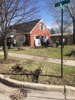 This photo shows where the Cadillac jumped the curb as it traveled southbound on Maple Avenue, crossing over the northbound lanes and into the home at 2801 Maple Ave. (Photo courtesy of the Brookfield Police Department)