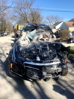 Bricks and cinder blocks crashed onto the top of the Cadillac after it hit the home. The car itself went halfway into the house. (Photo courtesy of the Brookfield Police Department)
