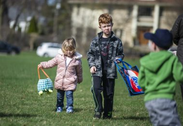 Children carry their Easter baskets and wait for the hunt to begin during the Riverside Parks and Rec's annual Easter Egg Hunt at Big Ball Park on April 13. | Alexa Rogals/Staff Photographer