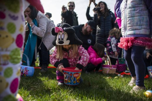 Kids scoop up Easter eggs during the annual Easter Egg Hunt hosted by Riverside Parks and Rec at Big Ball Park on April 13. | Alexa Rogals/Staff Photographer