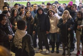 The family of the student who died of a self inflicted gunshot wound in a bathroom at the school listen to classmates speak on April 18, during a community prayer outside of the front entrance of George Washington Middle School.   ALEXA ROGALS/Staff Photographer