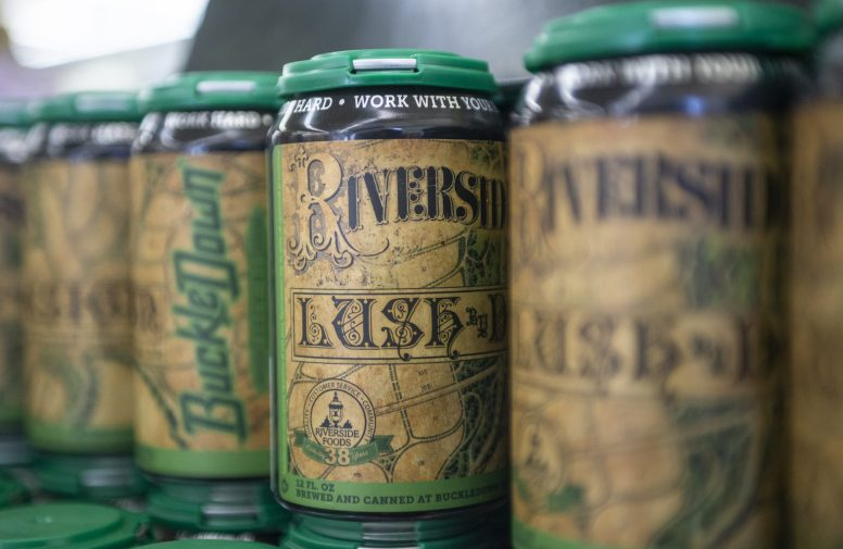 BuckleDown Brewery's Lush by Design ale celebrates the 150th birthday of Frederick Law Olmsted's 1869 General Plan of Riverside, which features prominently on the label. (Alexa Rogals | Staff)