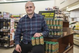 Riverside Foods co-owner Peter Boutsikakis says from the sale of each six-pack of Lush by Design ale will benefit the Frederick Law Olmsted Society and Riverside Arts Center. (Alexa Rogals | Staff)