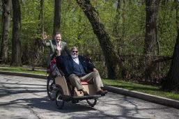 "Chicago Scots President Gus Noble (above, left) and retired Caledonia Senior Living administrator Jim Boyle take one of the new ""trishaws"" for a spin on the grounds of the nursing home facility on May 3. Caledonia is the first Illinois chapter of Cycling Without Age, a group that seeks to get senior citizens back on bikes. 