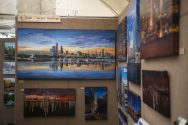 Acrylic paintings done by artist Val Fischer is seen up on display and for sale on, May 18, during the Riverside Arts Weekend, also known as RAW, at Guthrie Park in Riverside. | Alexa Rogals/Staff Photographer