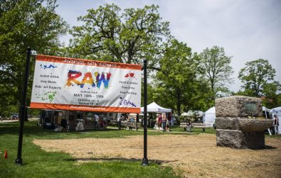 Attendees walk into the front entrance on May 18,during the Riverside Arts Weekend, also known as RAW, at Guthrie Park in Riverside. | Alexa Rogals/Staff Photographer