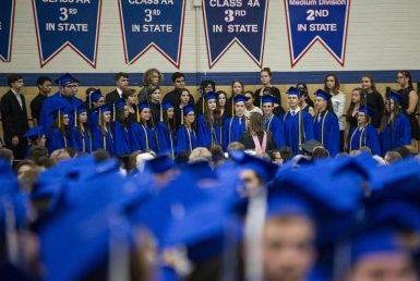 Graduates join the choir to sing their last song together on Friday, May 24, during the class of 2019 commencement inside the gymnasium at Riverside Brookfield High School in Riverside. | Alexa Rogals/Staff Photographer