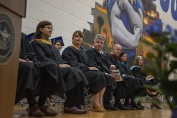 Board members listen to speakers during the class of 2019 commencement inside the gymnasium at Riverside Brookfield High School in Riverside. | Alexa Rogals/Staff Photographer