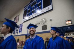 Graduates make their way through the school during the class of 2019 commencement inside the gymnasium at Riverside Brookfield High School in Riverside. | Alexa Rogals/Staff Photographer