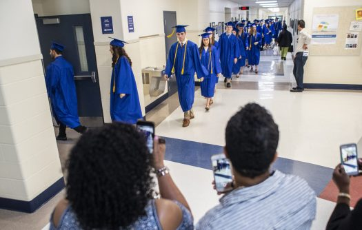 Attendees take photos and videos as the graduates make their way through the school during the class of 2019 commencement inside the gymnasium at Riverside Brookfield High School in Riverside. | Alexa Rogals/Staff Photographer