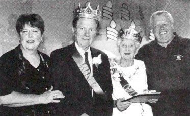 """Bill Svrluga Sr. (second from left) in 1998, when he was crowned King of North Riverside for the village's 75th anniversary celebration. Standing with him (from left) are Village Clerk Charmaine Kutt, North Riverside """"Queen"""" Violet Greco and Mayor Richard Scheck. 