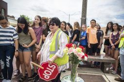Sendoff: On June 5, 37 students from S.E. Gross Middle School placed carnations in a vase in front crossing guard Mary Morrill to mark every year she stood sentinel at Eight Corners, braving the traffic and ushering children to and from school every morning and afternoon. Morrill retired last week. | ALEXA ROGALS/Staff photographer
