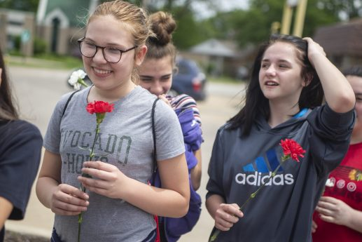 Students (above) line up to present Morrill with flowers on her final day on the job, June 5. | Photo by Alexa Rogals/ Staff Photographer