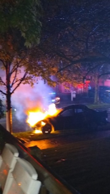 After striking a tree in front of 100 E. Burlington St., the car caught fire. (Photo courtesy of the Riverside Fire Department)