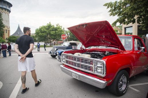 Attendees look under the hood on Thursday, June 20, at the first night of the Cruise Nights event in downtown Riverside, Ill. | ALEXA ROGALS/Staff Photographer