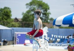 Kids do cannonballs off of the diving board on Saturday, June 29, at the Riverside Swim Club in Riverside, Ill. | ALEXA ROGALS/Staff Photographer