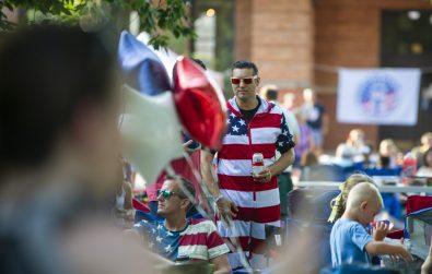 Attendees wear American flag apparel on Wednesday, July 3, during the Concert in the Park event at Guthrie Park in Riverside. (ALEXA ROGALS/Staff Photographer)