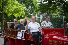 Deputy Fire Chief Bill Sherman, 2019's Riverside Person of the Year, is chauffeured in the antique fire engine at the beginning of the Fourth of July parade in Riverside. (ALEXA ROGALS/Staff Photographer)