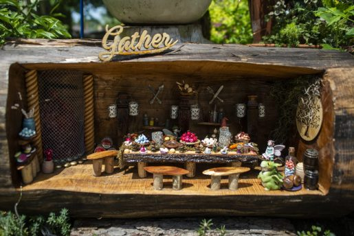 A room built into a log of wood is seen in the fairy garden on Saturday, June 22, on Vernon Avenue in Brookfield, Ill. (ALEXA ROGALS/Staff Photographer)