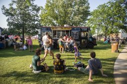 Attendees hang out in the shade on Saturday, July 27 during the North Riverside village block party in front of Village Commons on Des Plaines Avenue in North Riverside, Ill.(ALEXA ROGALS/Staff Photographer)