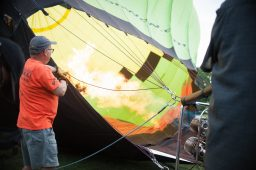 Pilots blasting the burner flames to inflate the parachute for Riverside's Hot Air Balloon Affair on Saturday, Aug. 10, at Big Ball Park in Riverside, Ill. | SHANEL ROMAIN/Contributor