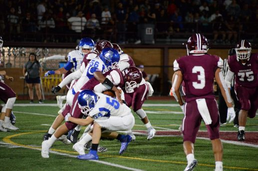 RBHS juniors Terrence Moody (#56) and Luke Swiatek (#54) tackle a Morton player in the season opener on Aug. 30 (Photo by Carol Dunning)