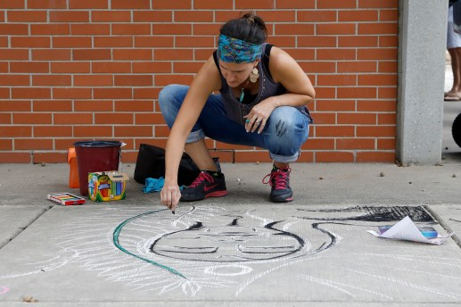 Deanna Gordon, of Brookfield, works on her sidewalk art Saturday, Sept. 21 at the Brookfield Fine Arts Festival.