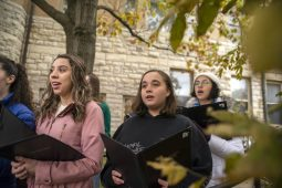 Students from Riverside-Brookfield High School sing patriotic songs as part of the 125th anniversary event to commemorate the laying of the cornerstone at the Riverside Township Hall. (ALEX ROGALS/Staff Photographer)