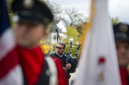 Members of the Chicago Police Department Pipes and Drums play bagpipes on Nov. 3, during the 125th anniversary event at Riverside Township Hall. (ALEX ROGALS/Staff Photographer)