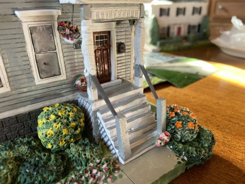 McCarthy's finished works are incredibly detailed, down to the brickwork, stained-glass windows and flowers in planters. (Bob Uphues/editor)