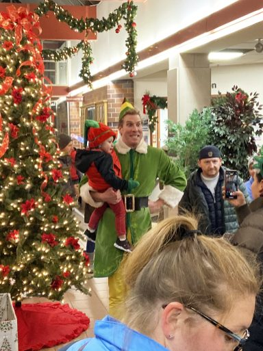 Buddy the Elf poses for a photos with young fans whose families escaped the cold for a few minutes inside the North Riverside Village Commons during the tree-lighting ceremony on Dec. 4. (Bob Uphues/Editor)