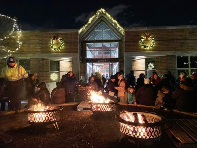 The fire pits set up outside the front of the North Riverside Village Commons were a popular spot for families looking for warmth while waiting for the fireworks during the tree-lighting ceremony on Dec. 4. (Bob Uphues/Editor)
