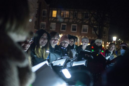 The Riverside-Brookfield High School Madrigals sing holiday songs to those gathered near water tower in Riverside on Dec. 6, waiting for Santa to light the tree and kick off the 45th annual Holiday Stroll.