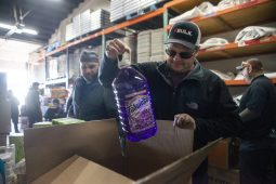 Volunteers pack up cleaning supplies and food items for families in need on Dec. 22, at Twilight Party Rentals in Brookfield. | ALEX ROGALS/Staff Photographer