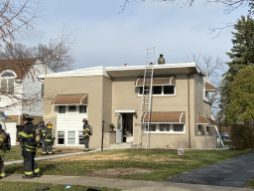 Firefighters attend to hotspots on the roof of 540 Selborne Road in Riverside, where a fire started apparently while the roof was being repaired on the morning of Nov. 21. | Bob Uphues/Editor