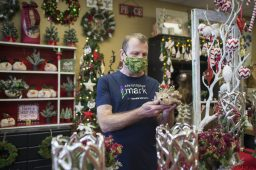 """Chris Borzym had expected a blowout party amid a sea of holiday decorations for Christopher Mark Fine Flowers' 15th anniversary last week and looked forward to another holiday open house in early December, but COVID dashed those plans. Instead, he's looking forward to a """"Sweet 16"""" party next November. (Alex Rogals/Staff Photographer)"""