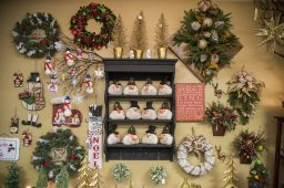 Different holiday-themed decorations and arrangements are displayed on one of the walls inside the store on Nov. 20, at Christopher Mark Fine Flowers on Grand Boulevard in Brookfield. (Alex Rogals/Staff Photographer)