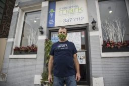 Shop owner Chris Borzym, stands for a photo outside the front entrance on Nov. 20, at Christopher Mark Fine Flowers on Grand Boulevard in Brookfield. (Alex Rogals/Staff Photographer)
