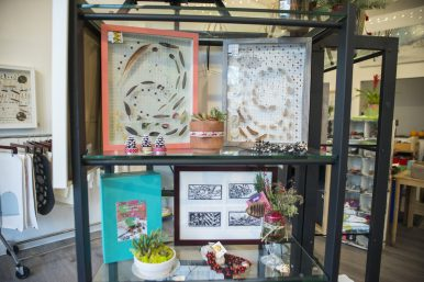 Gifts at The Seed include botanical boxes, handcrafted cards, botanical pillows, tea towels handmade from organic fibers, sculptures and necklaces made from blue gem corn. (Alex Rogals/Staff Photographer)