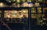 The Chicago Skyliners Holiday Trio, featuring singer/saxophonist Vinson Johnson (right), Bobby Schiff on keys (left) and drummer Bill O'Connell (not pictured) helped Riverside swing into the holidays during a local stop by the Fitzgeralds Community Christmas Bus on Dec. 10. The bus made a return trip on Dec. 12, and more stops may be planned depending on demand. (Alex Rogals/Staff Photographer)