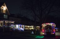 The Fitzgerald's holiday bus drives down the road with a live jazz band playing for residents on Dec. 10, in Riverside. (Alex Rogals/Staff Photographer)