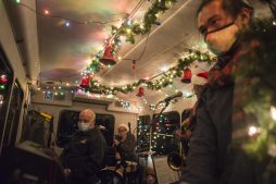 The jazz band in the Fitzgerald's holiday bus plays live music for residents on Dec. 10, in Riverside. (Alex Rogals/Staff Photographer)
