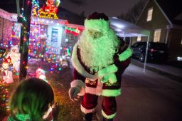 Brian Pryzybylski dresses as Santa to greet visitors like 3-year-old twins Maggie and Carolina Rotolo, of Clarendon Hills. (Alex Rogals/Staff Photographer)